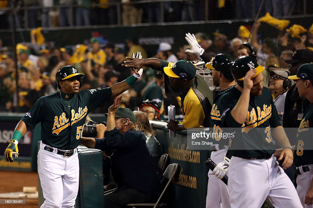 Yoenis Cespedes #52 of the Oakland Athletics celebrates after hitting a two run home run in the seventh inning against Max Scherzer #37 of the Detroit Tigers during Game One of the American League Division Series at O.co Coliseum on October 4, 2013 in Oakland, California.