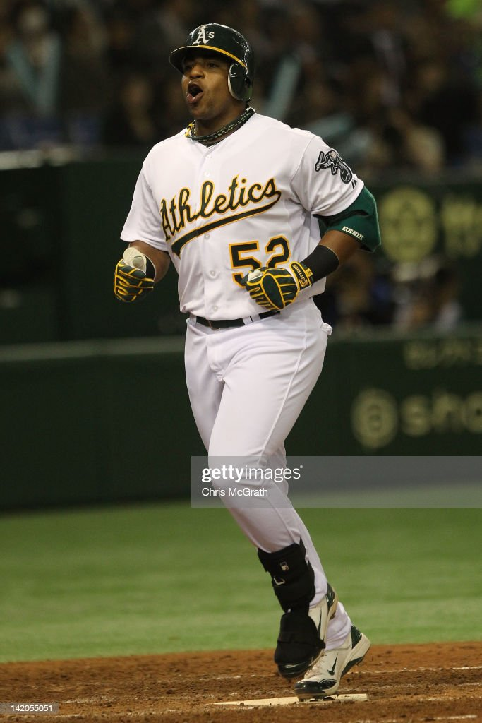 <a gi-track='captionPersonalityLinkClicked' href=/galleries/search?phrase=Yoenis+Cespedes&family=editorial&specificpeople=8892047 ng-click='$event.stopPropagation()'>Yoenis Cespedes</a> #52 of the Oakland Athletics celebrates as he runs home after hitting a two run homer in the seventh inning against the Seattle Mariners during the MLB Opening Series game two between the Seattle Mariners and Oakland Athletics at Tokyo Dome on March 29, 2012 in Tokyo, Japan.