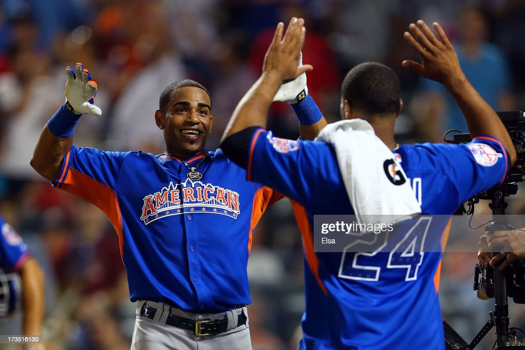 Yoenis Cespedes of the Oakland Athletics celebrates with Robinson Cano of the New York Yankees after winning the Chevrolet Home Run Derby on July 15, 2013 at Citi Field in the Flushing neighborhood of the Queens borough of New York City.