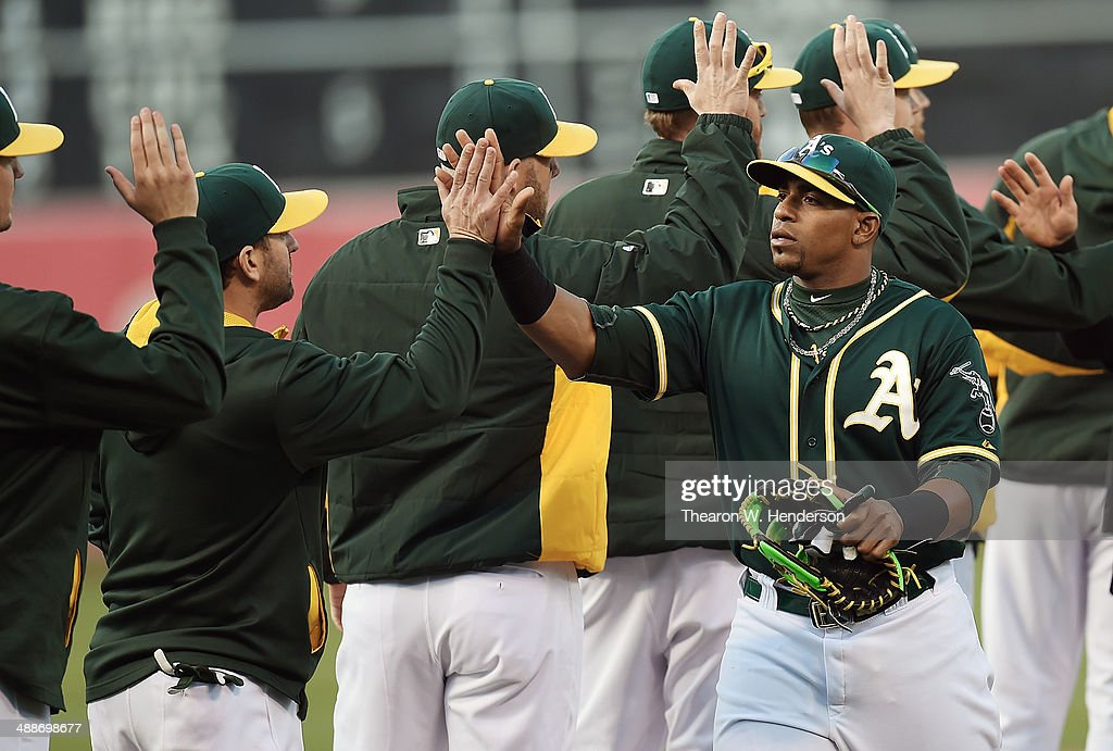 <a gi-track='captionPersonalityLinkClicked' href=/galleries/search?phrase=Yoenis+Cespedes&family=editorial&specificpeople=8892047 ng-click='$event.stopPropagation()'>Yoenis Cespedes</a> #52 of the Oakland Athletics celebrates with teammates defeating the Seattle Mariners 2-0 during game two of a doubleheader at O.co Coliseum on May 7, 2014 in Oakland, California.