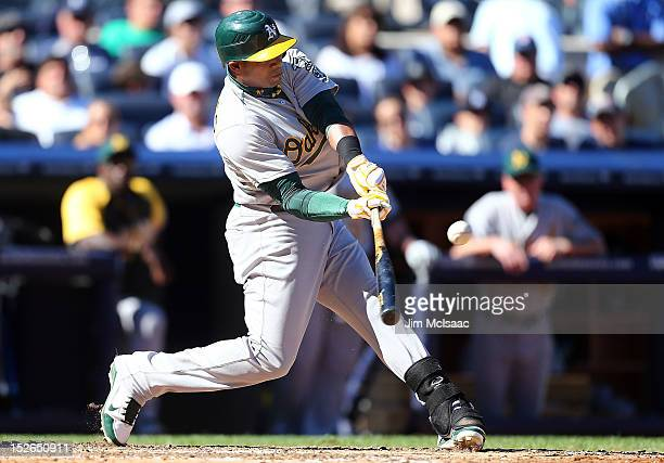 Yoenis Cespedes of the Oakland Athletics connects on a fifth inning RBI base hit against the New York Yankees at Yankee Stadium on September 23 2012...