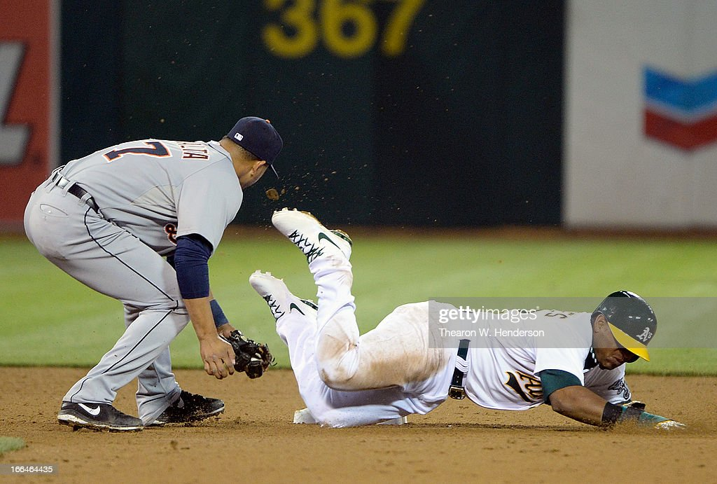 <a gi-track='captionPersonalityLinkClicked' href=/galleries/search?phrase=Yoenis+Cespedes&family=editorial&specificpeople=8892047 ng-click='$event.stopPropagation()'>Yoenis Cespedes</a> #52 of the Oakland Athletics gets caught stealing and tagged out by <a gi-track='captionPersonalityLinkClicked' href=/galleries/search?phrase=Jhonny+Peralta&family=editorial&specificpeople=213286 ng-click='$event.stopPropagation()'>Jhonny Peralta</a> #27 of the Detroit Tigers in the bottom of the eighth inning at O.co Coliseum on April 12, 2013 in Oakland, California.