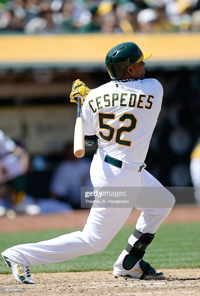 Yoenis Cespedes #52 of the Oakland Athletics hits a single against the Baltimore Orioles in the six inning at O.co Coliseum on April 28, 2013 in Oakland, California.