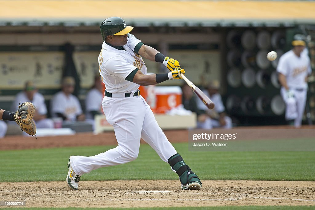 <a gi-track='captionPersonalityLinkClicked' href=/galleries/search?phrase=Yoenis+Cespedes&family=editorial&specificpeople=8892047 ng-click='$event.stopPropagation()'>Yoenis Cespedes</a> #52 of the Oakland Athletics hits a two RBI double against the San Francisco Giants during the seventh inning of the interleague game at O.co Coliseum on May 27, 2013 in Oakland, California.