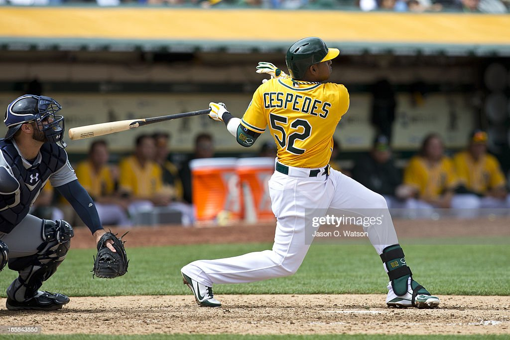 <a gi-track='captionPersonalityLinkClicked' href=/galleries/search?phrase=Yoenis+Cespedes&family=editorial&specificpeople=8892047 ng-click='$event.stopPropagation()'>Yoenis Cespedes</a> #52 of the Oakland Athletics hits a two run home run against the Seattle Mariners during the sixth inning at O.co Coliseum on April 4, 2013 in Oakland, California. The Oakland Athletics defeated the Seattle Mariners 8-2.