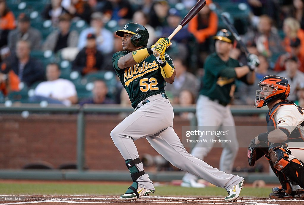 <a gi-track='captionPersonalityLinkClicked' href=/galleries/search?phrase=Yoenis+Cespedes&family=editorial&specificpeople=8892047 ng-click='$event.stopPropagation()'>Yoenis Cespedes</a> #52 of the Oakland Athletics hits an RBI triple driving in Coco Crisp #4 against the San Francisco Giants in the first inning at AT&T Park on May 29, 2013 in San Francisco, California.