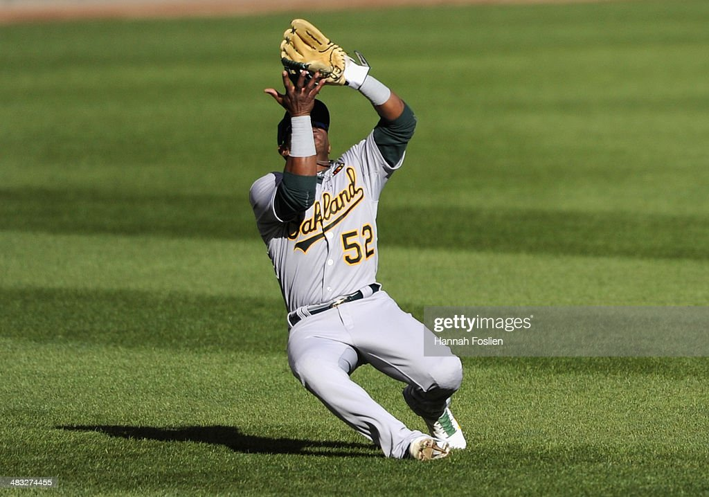 <a gi-track='captionPersonalityLinkClicked' href=/galleries/search?phrase=Yoenis+Cespedes&family=editorial&specificpeople=8892047 ng-click='$event.stopPropagation()'>Yoenis Cespedes</a> #52 of the Oakland Athletics makes a catch in left field during the sixth inning of the home opening game against the Minnesota Twins on April 7, 2014 at Target Field in Minneapolis, Minnesota. The Athletics defeated the Twins 8-3.