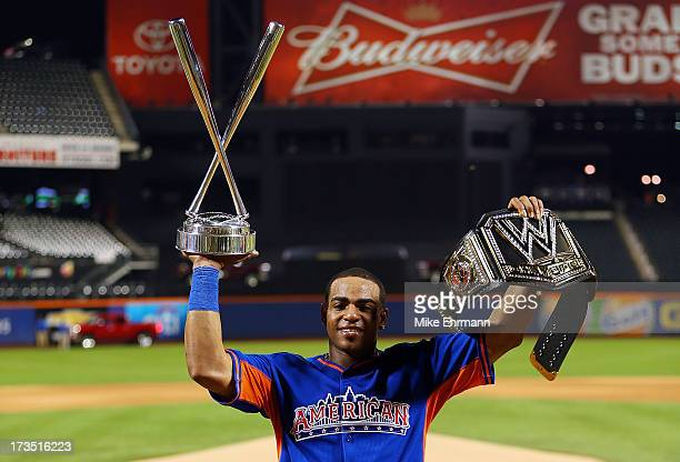 Yoenis Cespedes of the Oakland Athletics poses with the trophy after winning Chevrolet Home Run Derby on July 15 2013 at Citi Field in the Flushing...