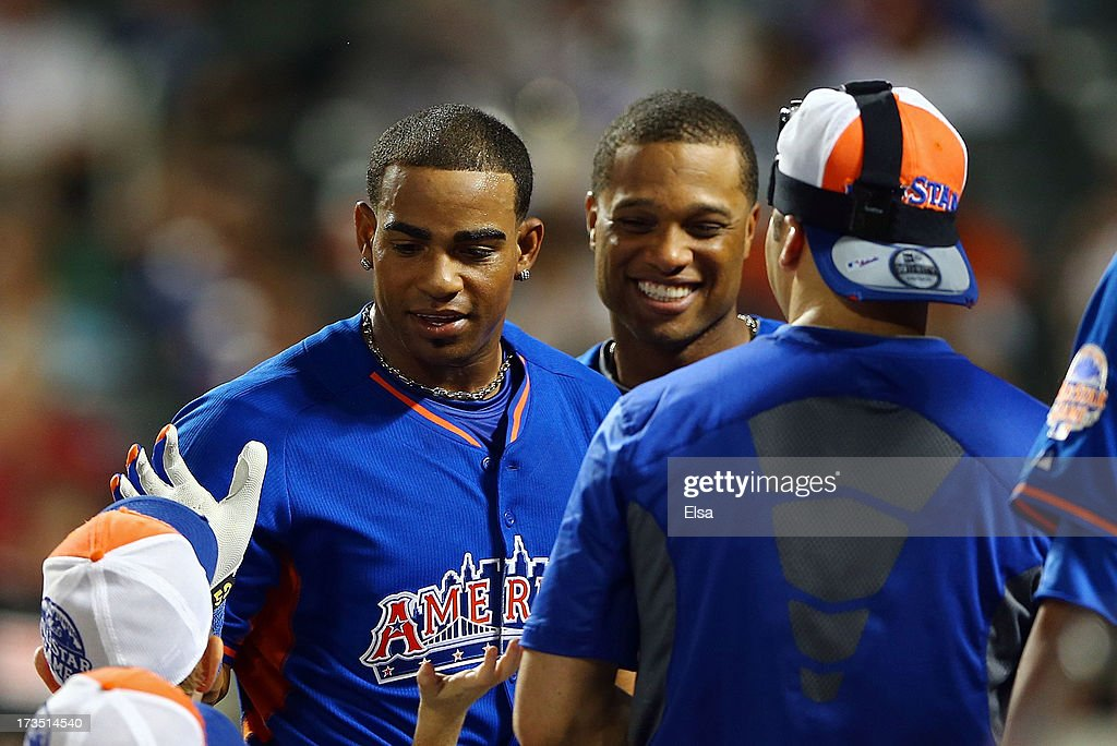 Yoenis Cespedes of the Oakland Athletics reacts after hitting in the second round of the Chevrolet Home Run Derby as Robinson Cano of the New York Yankees look on on July 15, 2013 at Citi Field in the Flushing neighborhood of the Queens borough of New York City.