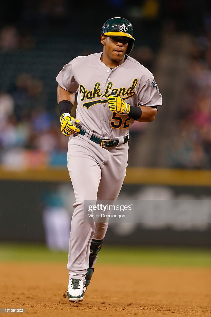 <a gi-track='captionPersonalityLinkClicked' href=/galleries/search?phrase=Yoenis+Cespedes&family=editorial&specificpeople=8892047 ng-click='$event.stopPropagation()'>Yoenis Cespedes</a> #52 of the Oakland Athletics rounds the bases after hitting a two-run home run in the ninth inning against the Seattle Mariners at Safeco Field on June 21, 2013 in Seattle, Washington. The Athletics defeated the Mariners 6-3.