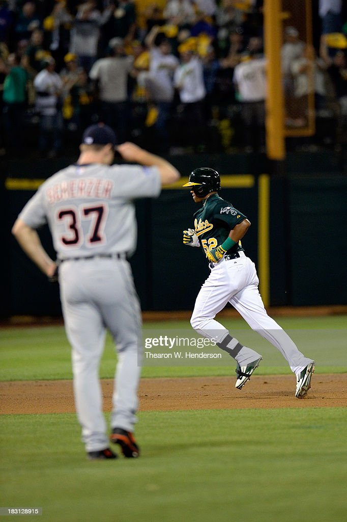 Yoenis Cespedes #52 of the Oakland Athletics runs the bases after hitting a two run home run in the seventh inning against Max Scherzer #37 of the Detroit Tigers during Game One of the American League Division Series at O.co Coliseum on October 4, 2013 in Oakland, California.
