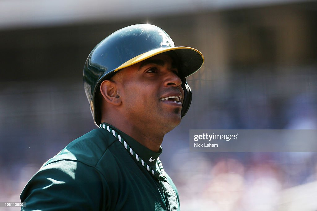 Yoenis Cespedes #52 of the Oakland Athletics smiles in the dugout after a 2 RBI home run against the New York Yankees at Yankee Stadium on May 5, 2013 in the Bronx borough of New York City.