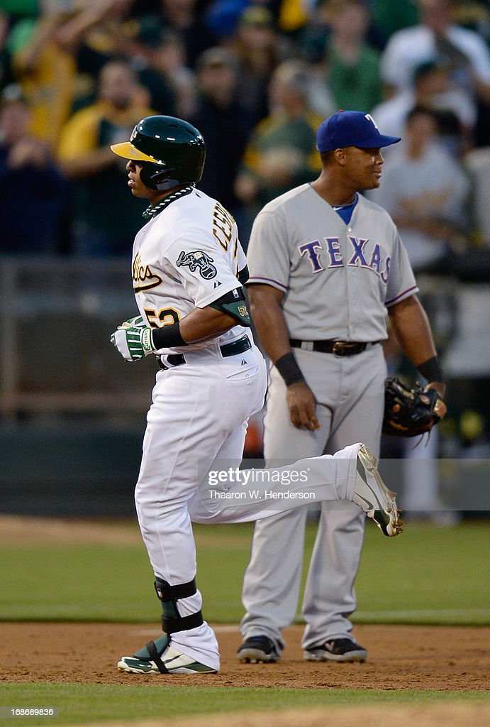 <a gi-track='captionPersonalityLinkClicked' href=/galleries/search?phrase=Yoenis+Cespedes&family=editorial&specificpeople=8892047 ng-click='$event.stopPropagation()'>Yoenis Cespedes</a> #52 of the Oakland Athletics trots around the bases after hitting a solo home run as third baseman <a gi-track='captionPersonalityLinkClicked' href=/galleries/search?phrase=Adrian+Beltre&family=editorial&specificpeople=202631 ng-click='$event.stopPropagation()'>Adrian Beltre</a> #29 of the Texas Rangers looks on in the third inning at O.co Coliseum on May 13, 2013 in Oakland, California.