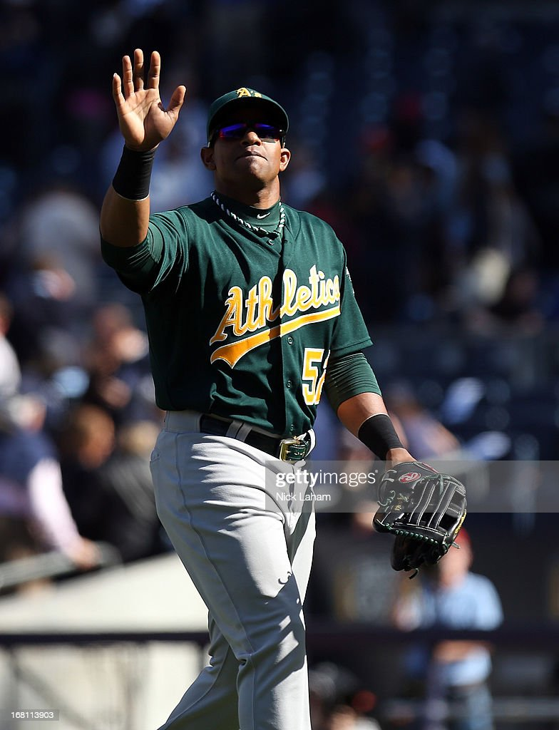 Yoenis Cespedes #52 of the Oakland Athletics waves to the crowd after the win against the New York Yankees at Yankee Stadium on May 5, 2013 in the Bronx borough of New York City.