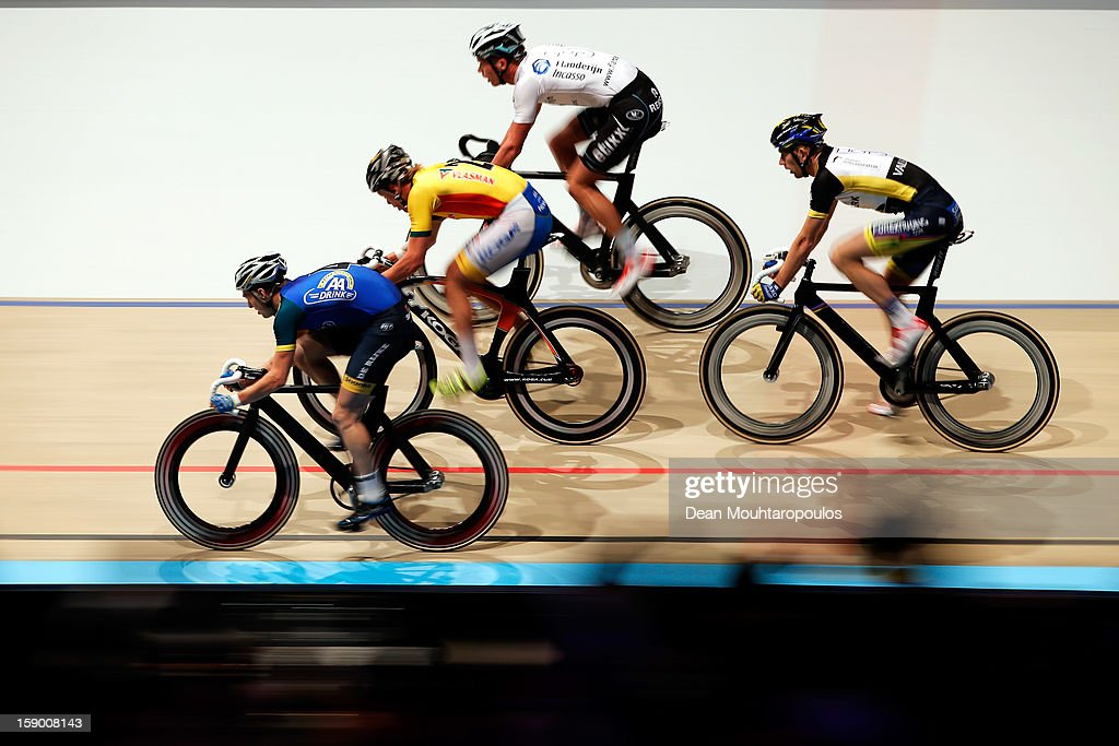 Yoeri Havik (blue top) of Netherlands, Wim Stroetinga (yellow top) of Netherlands, Iljo Keisse (white top) of Belgium and Michael Morkov (black & white top) of Denmark compete in the Team Knockout Race during the Rotterdam 6 Day Cycling at Ahoy Rotterdam on January 5, 2013 in Rotterdam, Netherlands.