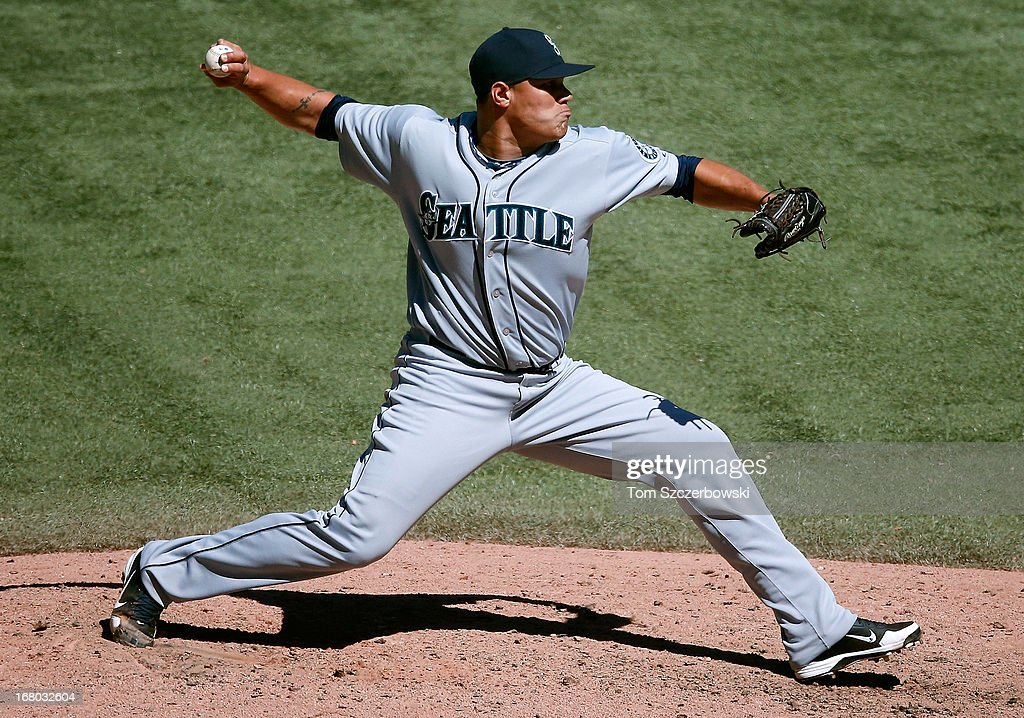 Yoervis Medina #31 of the Seattle Mariners delivers a pitch during MLB game action against the Toronto Blue Jays on May 4, 2013 at Rogers Centre in Toronto, Ontario, Canada.