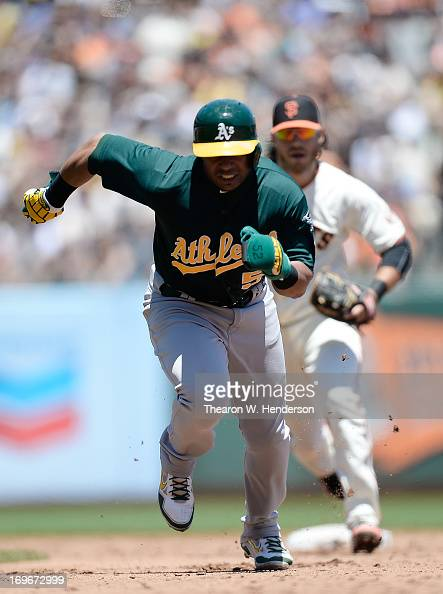 Yoesnis Cespedes of the Oakland Athletics gets caught in a rundown chased by Brandon Crawford of the San Francisco Giants in the third inning at ATT...