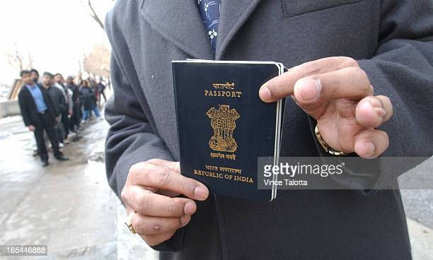 LINEUPS 3/17/03 Yog Gorur picks up his India passport from the US CONSULATE in Toronto while other people lineup in front of US CONSULATE to apply or...