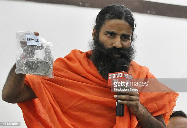 Yog guru Baba Ramdev addresses a press conference on his controversial Ayurvedic medicines 'Putra Jeevak Beej' at Constitution Club on May 1 2015 in...