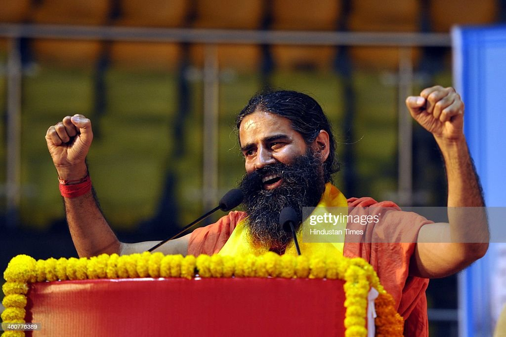 Yog Guru Baba Ramdev at the 5th foundation day celebrations of 'Bharat Swabhiman' on January 5, 2014 in New Delhi, India. Launching a fresh offensive against the Congress, Modi said, ''Dont trust anyone because of mere promises. Judge the track-record, and not tape record.' Modi promised to review and reform of the taxation system in the country, saying the existing structure is a burden on common man. Modi pointed out Ramdev, who had said his support to the saffron party would be issue-based, had joined the peoples movement. Modi further said, We have the will-power to transform the country. The way to end corruption is by making the state progressive and policy driven.'