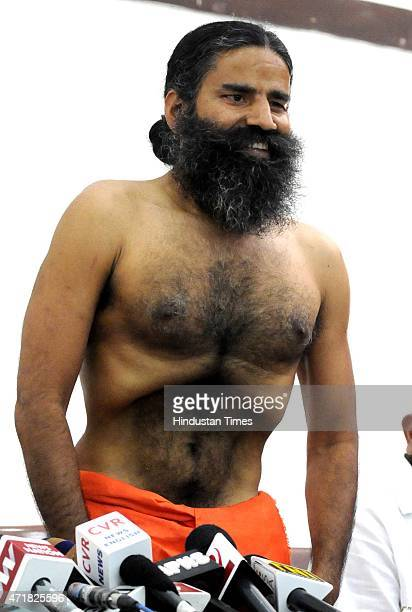 Yog guru Baba Ramdev shows Kapal Bharti as he addressing a press conference on his controversial Ayurvedic medicines 'Putra Jeevak Beej' at...