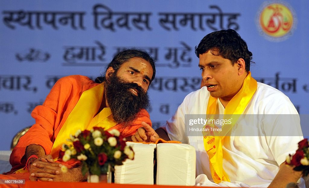 Yog Guru Baba Ramdev talking with Bal Krishna Maharaj at the 5th foundation day celebrations of 'Bharat Swabhiman' on January 5, 2014 in New Delhi, India. Launching a fresh offensive against the Congress, Modi said, ''Dont trust anyone because of mere promises. Judge the track-record, and not tape record.' Modi promised to review and reform of the taxation system in the country, saying the existing structure is a burden on common man. Modi pointed out Ramdev, who had said his support to the saffron party would be issue-based, had joined the peoples movement. Modi further said, We have the will-power to transform the country. The way to end corruption is by making the state progressive and policy driven.'