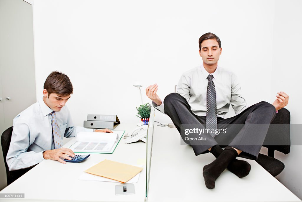 Yoga at the office : Stock Photo