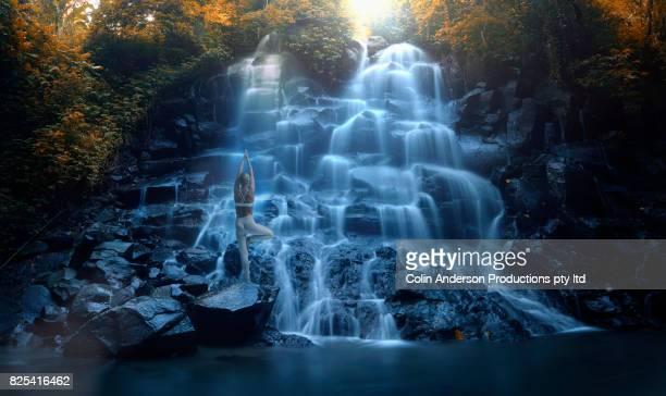 yoga by waterfall