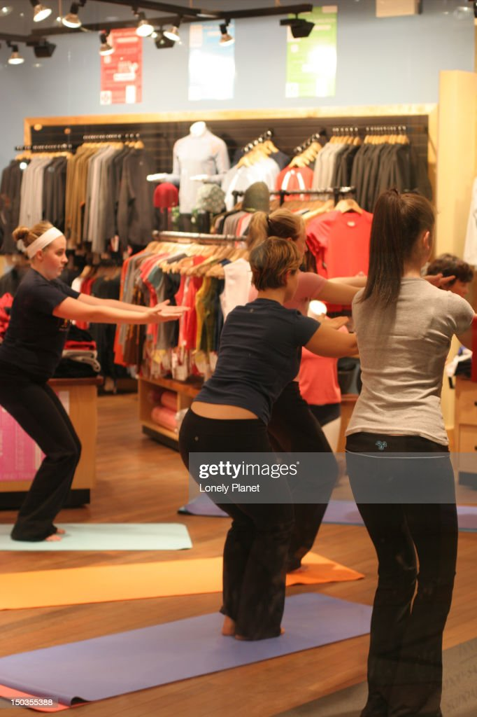 Yoga class at Lululemon at The Village at Park Royal, West Vancouver at Ambleside-by-the-Sea. : Stock Photo