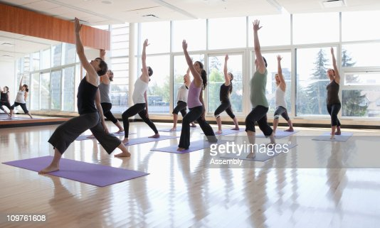 yoga class being led by instructor : Stock Photo