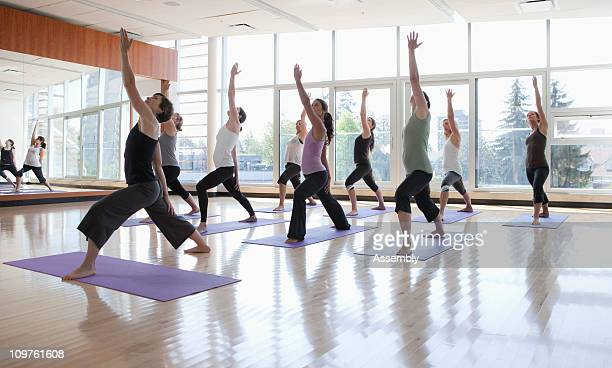 yoga class being led by instructor