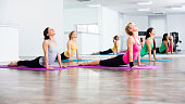 Four girls practicing yoga, Yoga-Bhujangasana/Cobra Pose