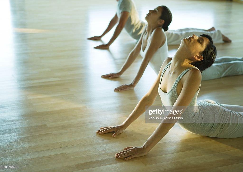 Yoga class doing cobra pose