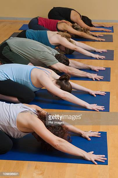 Yoga Class in 'Child's' pose