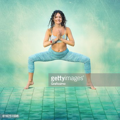 Yoga concept woman posing exercises outdoors turquoise : Stock Photo