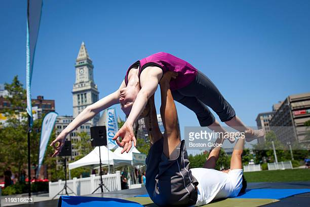 Yoga enthusiast Rachel Grey a software engineer from Somerville and Brian Lam an AcroYoga instructor from Wayland who works in greater Boston held an...