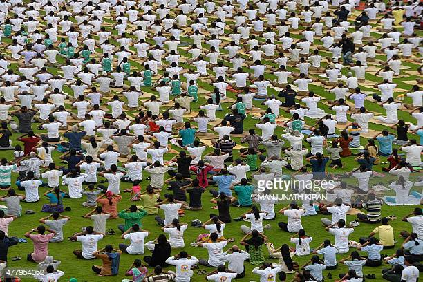 Yoga enthusiasts perform yoga during International Day of Yoga in Bangalore on June 21 2015 Prime Minister Narendra Modi hailed the first...