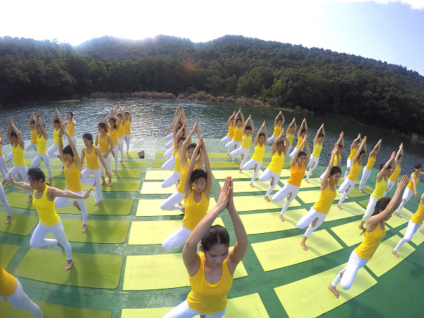 Yoga enthusiasts practice yoga on the water of Shiyan Lake on June 21 2016 in Changsha Hunan Province of China About 100 yoga enthusiasts perform...