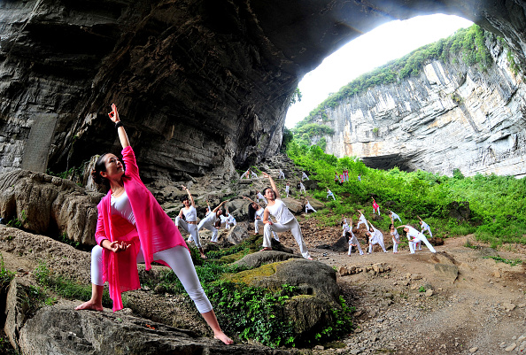 Yoga enthusiasts practise at Yueyandong cave in Dao County on September 11 2016 in Yongzhou Hunan Province of China More than 50 yoga enthusiasts...