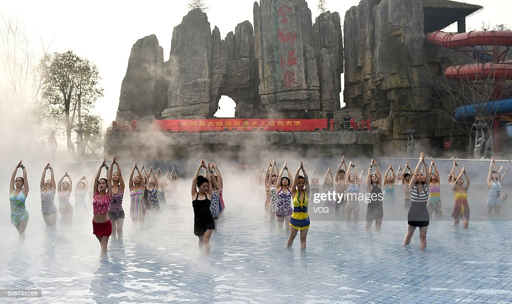 Yoga fans practice in a hot spring on January 17 2016 in Luoyang Henan Province of China Nearly a hundred yoga fans performed yoga in a hot spring as...