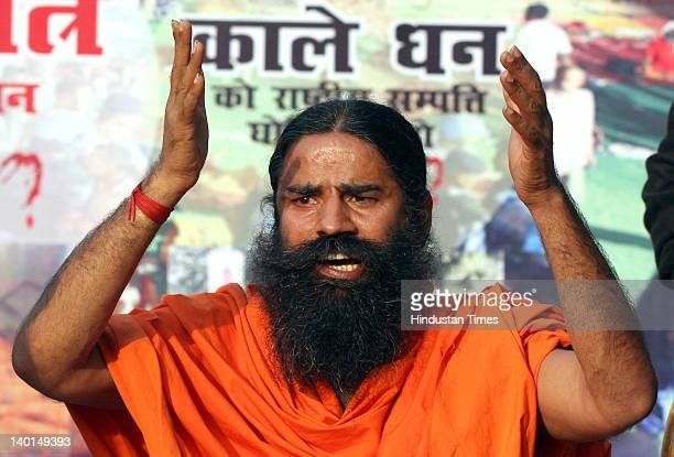 Yoga guru Baba Ramdev addressing press conference after Supreme Court Verdict on Ramlila Maidan lathi Charge case at Ram Jethmalani's residence on...