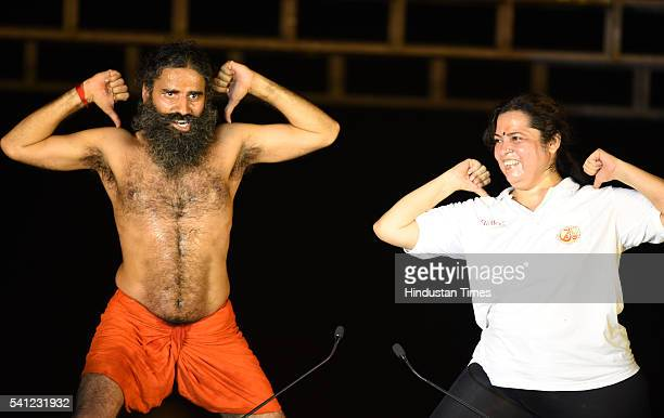Yoga Guru Baba Ramdev and BJP leader Meenakshi Lekhi perform yoga during the rehearsals for the upcoming International Yoga Day at Rajpath on June 19...