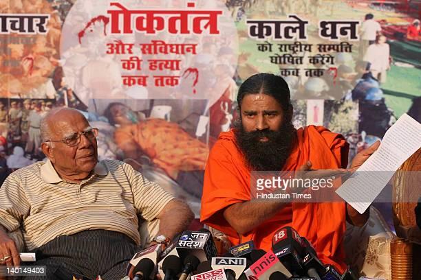 Yoga guru Baba Ramdev and Senior Advocate Ram Jethmalani address press conference after Supreme Court Verdict on Ramlila Maidan lathi Charge case at...