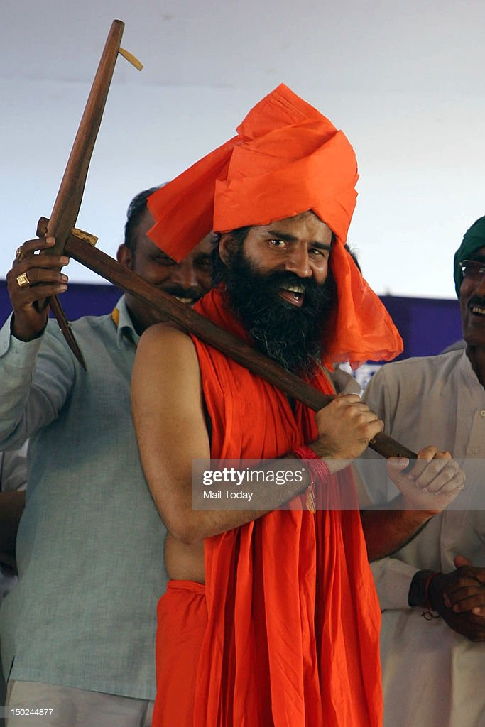 Yoga guru Baba Ramdev being presented a plough by farmers during the 2nd day of his agitation over corruption and black money at Ramlila Ground in New Delhi on Friday, 10th August, 2012.