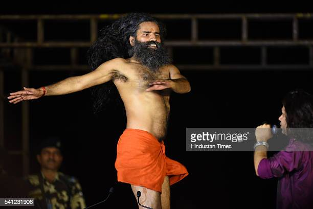 Yoga Guru Baba Ramdev performs yoga during the rehearsals for the upcoming International Yoga Day at Rajpath on June 19 2016 in New Delhi India...