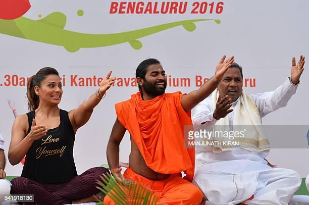 Yoga guru Vachanaananda conducts a laughter session with Chief Minister of Karnataka Siddaramaiah and Bollywood actress Bipasha Basu take part in a...