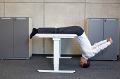 yoga in office. business man exercising at workplace