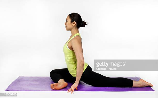 Yoga instructor Ingrid Yang demonstrates the pigeon pose April 23 in Chicago Illinois