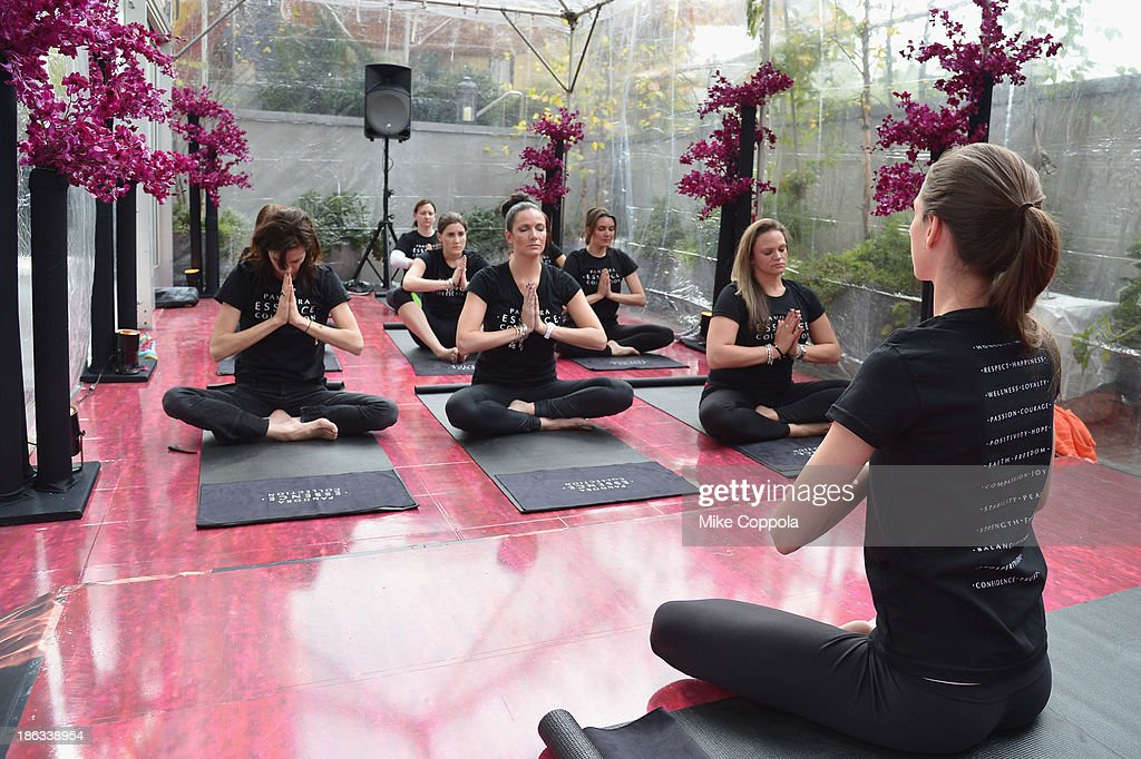 Yoga instructor Tara Stiles leads a yoga class at the Pandora Essence Collection Media Launch at The James New York on October 30, 2013 in New York City.