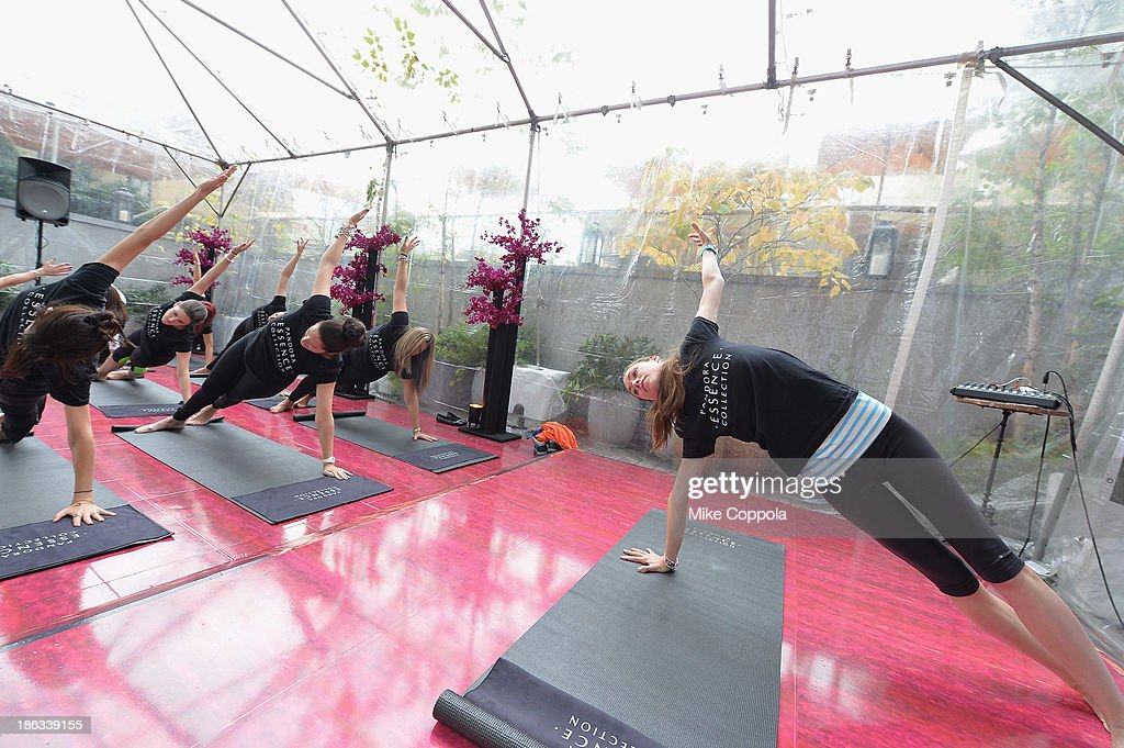 Yoga instructor Tara Stiles leads a yoga class at the Pandora Essence Collection Media Launch at the James Hotel on October 30, 2013 in New York City.